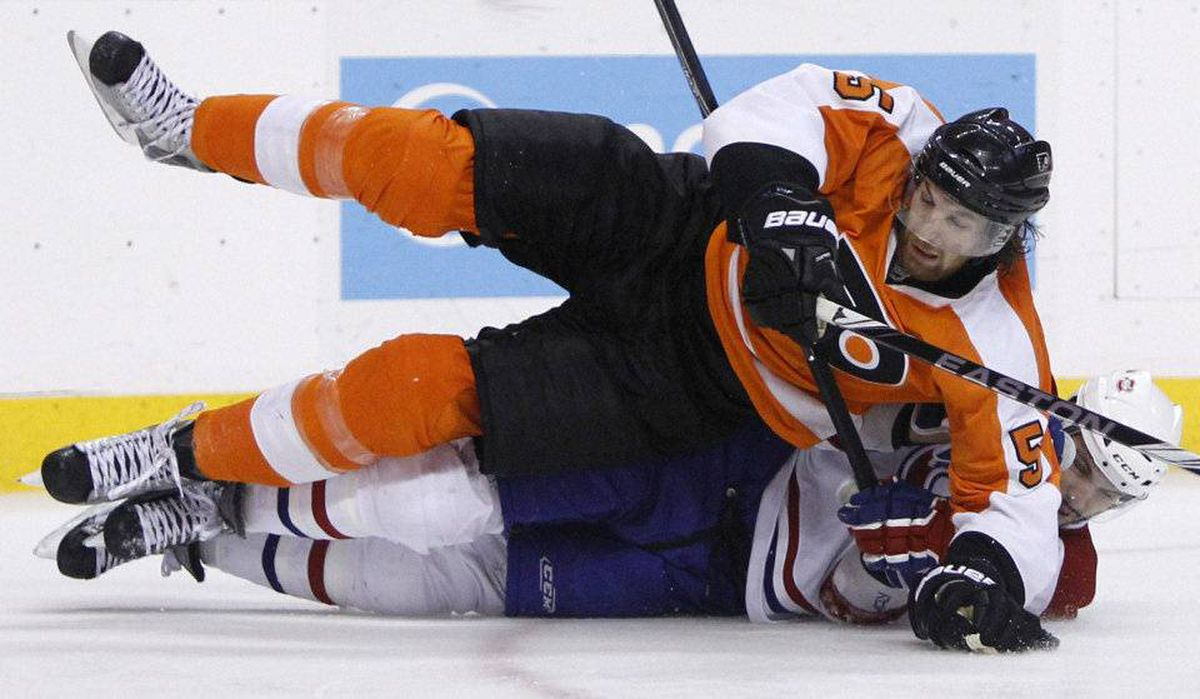 Philadelphia Flyers' Braydon Coburn, top, collides with Montreal Canadiens' Maxim Lapierre in the third period of Game 5 of the NHL hockey Eastern Conference finals, Monday, May 24, 2010, in Philadelphia. Philadelphia won 4-2 and took the series 4-1.