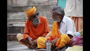 Rina Singh photo: Conversation - I found this sadhu in a deep conversation in Varanasi, India. With shades like that- you better take him seriously.