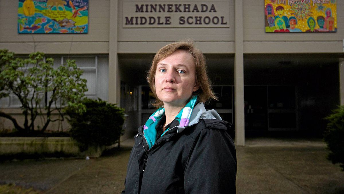Teacher Cheryl Angst outside Minnekhada Middle School where she teaches grade 6 and 7 in Port Coquitlam, B.C. Teachers in the province are set to begin a three-day strike Monday.