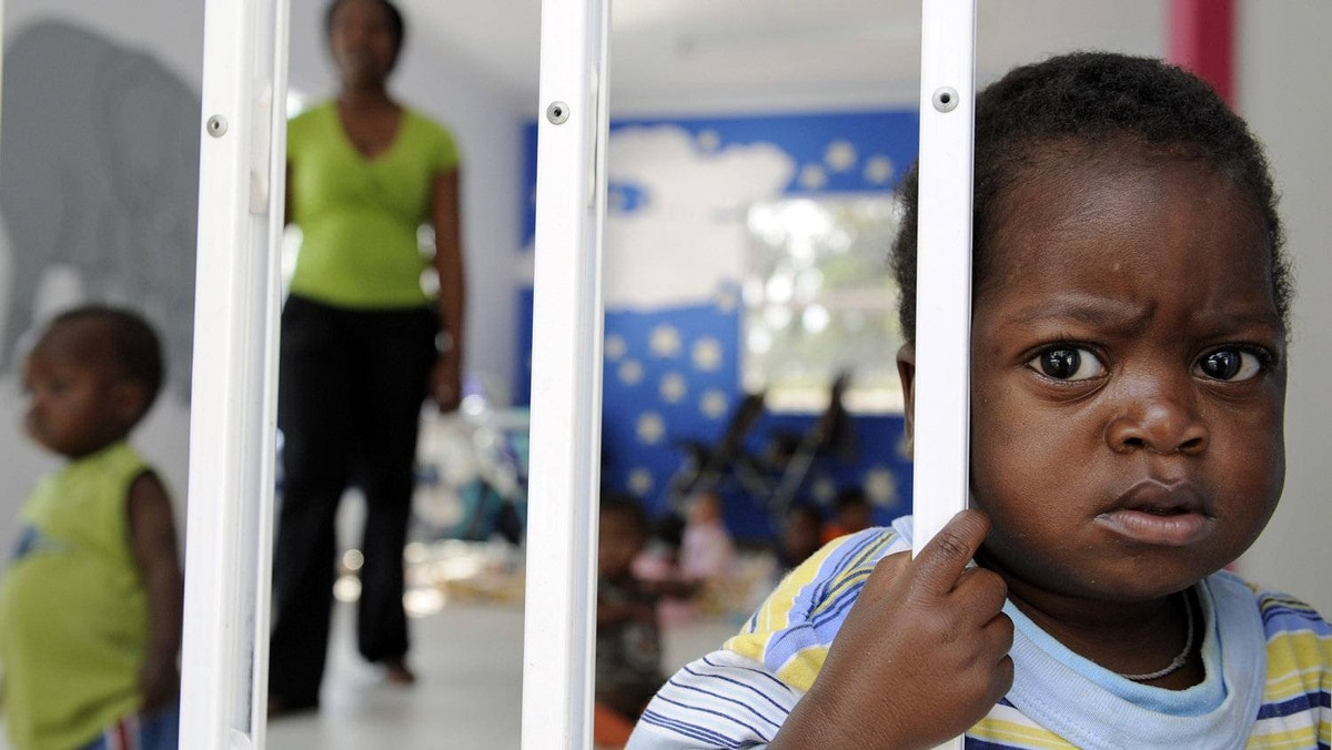 A child looks out from the play room at a shelter for destitute HIV-infected mothers in Johannesburg on Nov. 25, 2009.