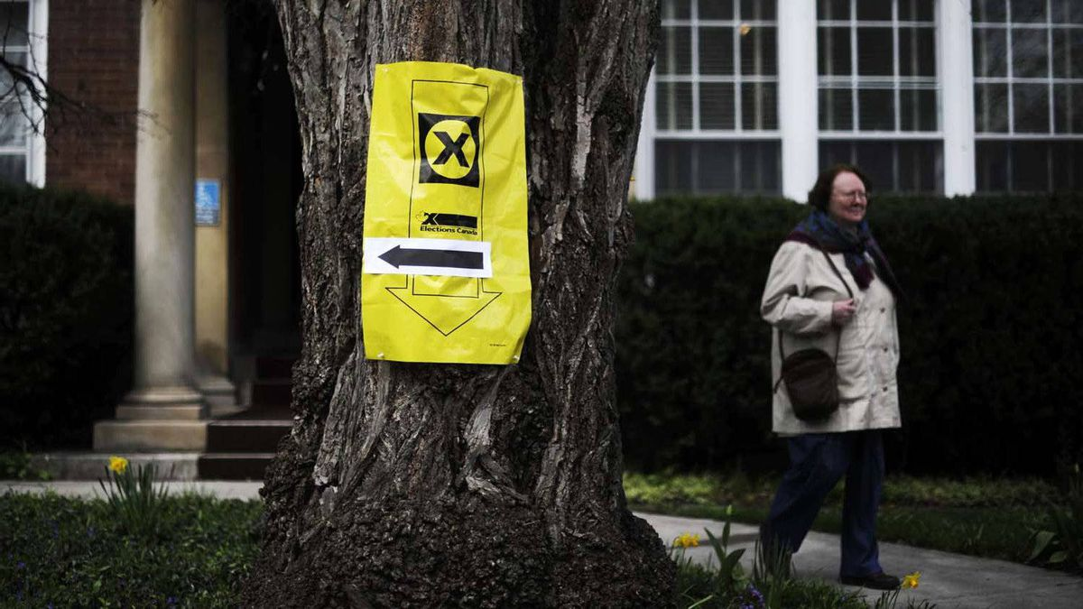A voter leaves a polling station in Toronto on Monday.