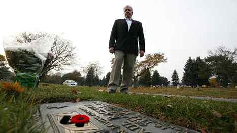 "Former fighter pilot, John ""Jock"" Williams poses for a portrait at the grave marker of his friend, a former pilot Captain Paul Rackham at Holy Cross Cemetery in Thornhill, Ontario, Canada."