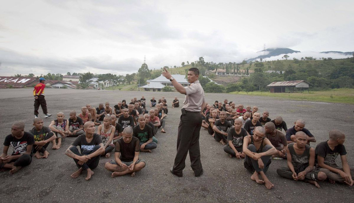 A police officer lectures a group of detained Indonesian punks at a police school in Aceh Besar in Aceh province.