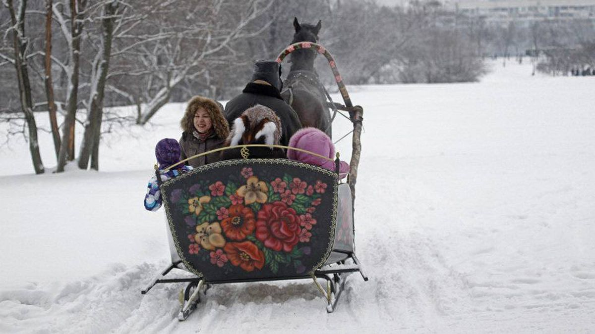 A horse-drawn sledge carries tourists during celebrations of Maslenitsa, or Pancake Week, in Kolomenskoye park, a former estate of the Russian Czars in Moscow, Saturday, Feb. 25, 2012.