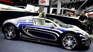 "Bugatti Veyron L'Or Blanc at the 2011 Frankfurt auto show. The one-off ""white gold"" Grand Sport vehicle is being built in co-operation with Germany's Konigliche Porzellan-Manufaktur, a centuries-old porcelain producer based in Berlin and will cost about $2.2-million."