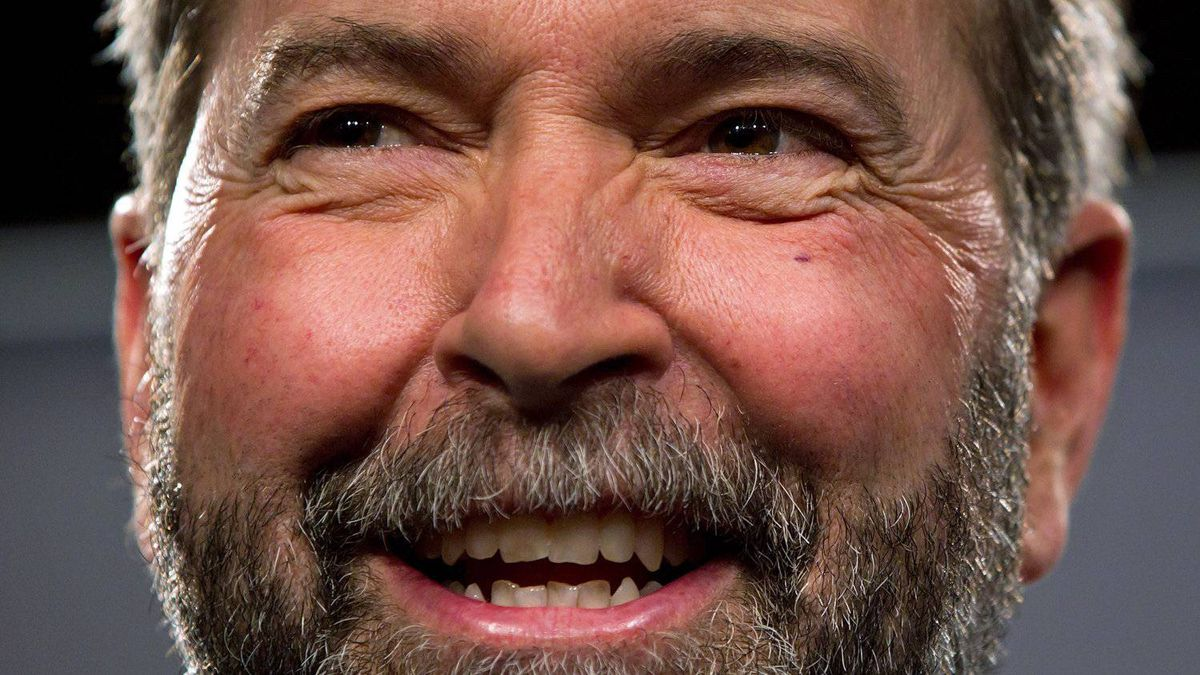 Quebec MP Thomas Mulcair smiles after the final NDP leadership debate in Vancouver on March 11, 2012.