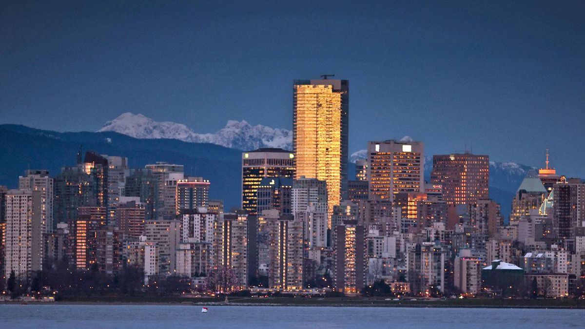 The sunset is reflected in Vancouver skyscrapers on Jan. 20, 2010.
