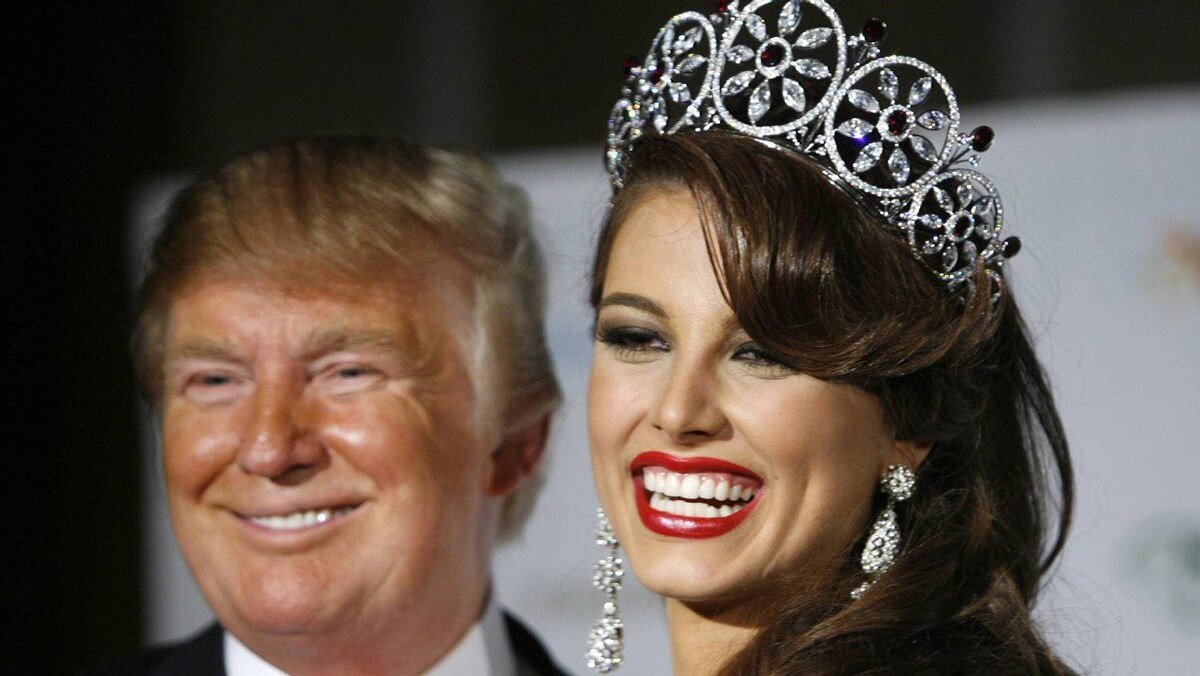 Miss Universe 2009 Stefania Fernandez of Venezuela smiles after winning the crown as she stands with Miss Universe organization owner Donald Trump during the annual pageant at Atlantis on Paradise Island in the Bahamas Aug. 23, 2009.