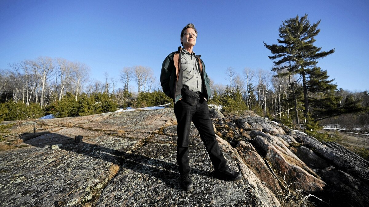 Ken Noble, a member of the Henvey Inlet First Nation is photographed standing on a rock outcrop overlooking Key Inlet. The band is in plans to develop a 300 megawatt wind power project on the 10 000 acres they own. The project will take advantage of the steady winds coming off nearby Georgian Bay and funds generated will allow them to develop needed social services for band members.