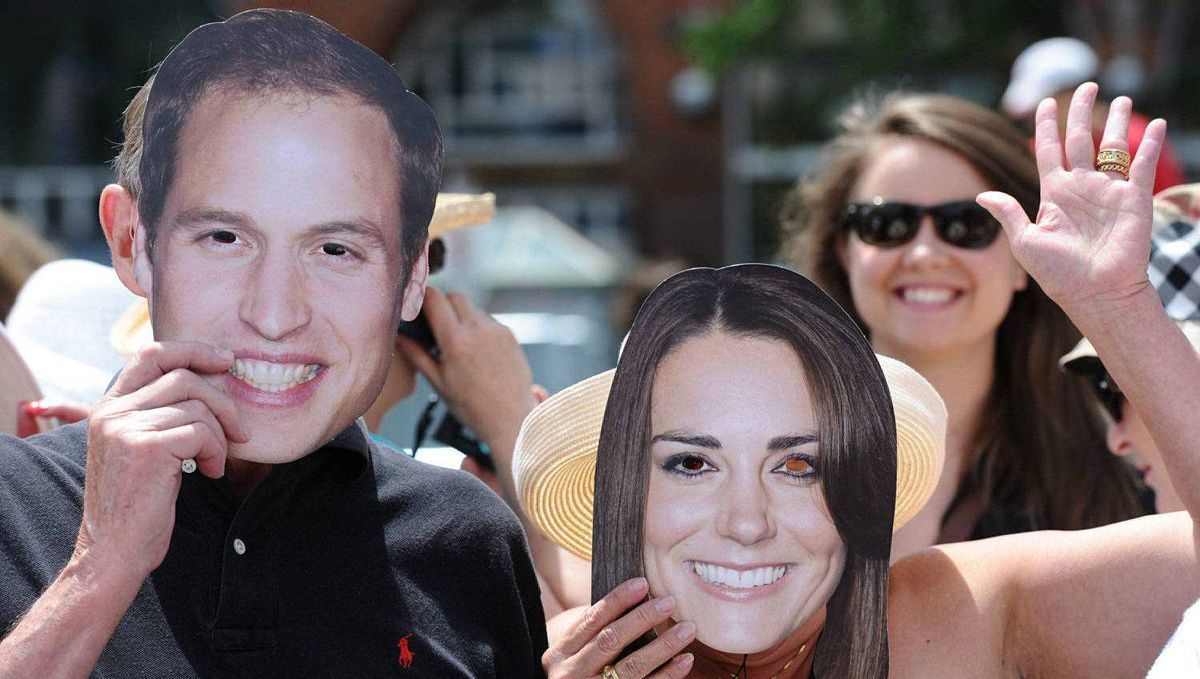 Royal watchers wear likenesses of the the Duke and Duchess of Cambridge as they await their arrival at the War Memorial in Ottawa, June 30, 2011.
