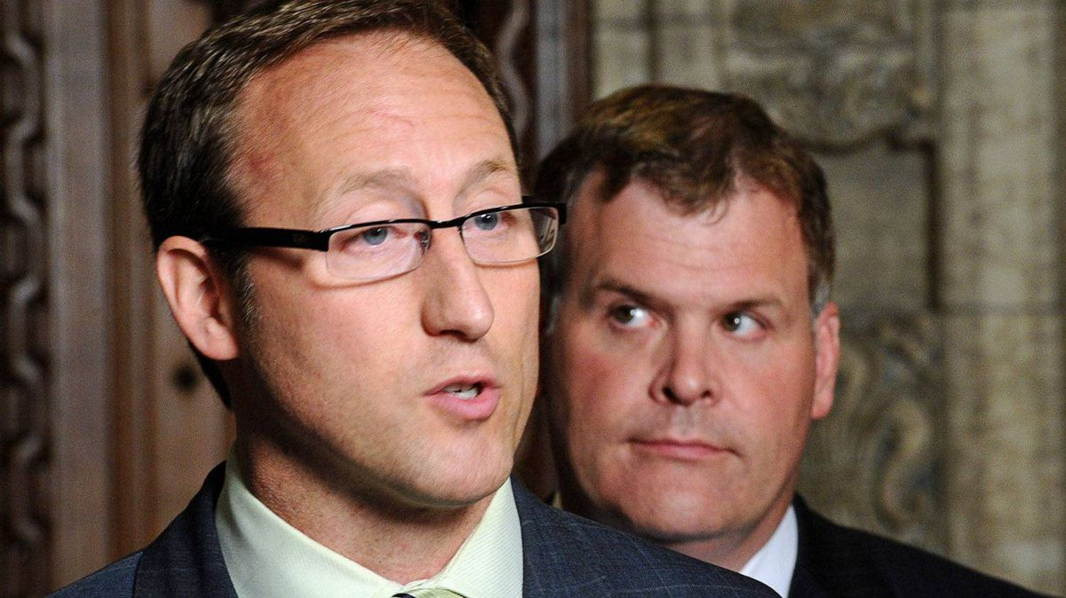 Defence Minister Peter MacKay Foreign Affairs Minister John Baird speak to reporters in the foyer of the House of Commons after the tabling of Afghan detainee documents on June 22, 2011.