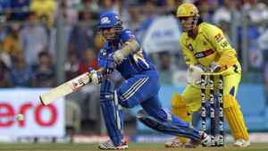 Chennai Super Kings captain Mahendra Singh Dhoni, right, reacts as Mumbai Indians' Sachin Tendulkar bats during an Indian Premier League (IPL) cricket match in Mumbai, India, Sunday, May 6, 2012.