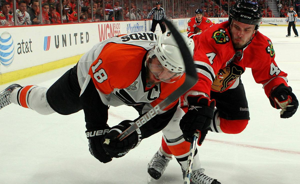 Mike Richards #18 of the Philadelphia Flyers skates against Niklas Hjalmarsson #4 of the Chicago Blackhawks in Game Five of the 2010 NHL Stanley Cup Final at the United Center on June 6, 2010 in Chicago, Illinois. (Photo by Bruce Bennett/Getty Images)