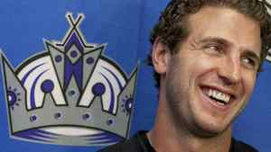 Los Angeles Kings Mike Richards is introduced during a hockey news conference, Wednesday, July 27, 2011, at the Toyota Sports Center in El Segundo, Calif. Richards was acquired from the Philadelphia Flyers in exchange for Wayne Simmonds, Brayden Schenn and a 2012 second-round draft pick. (AP Photo/Damian Dovarganes)