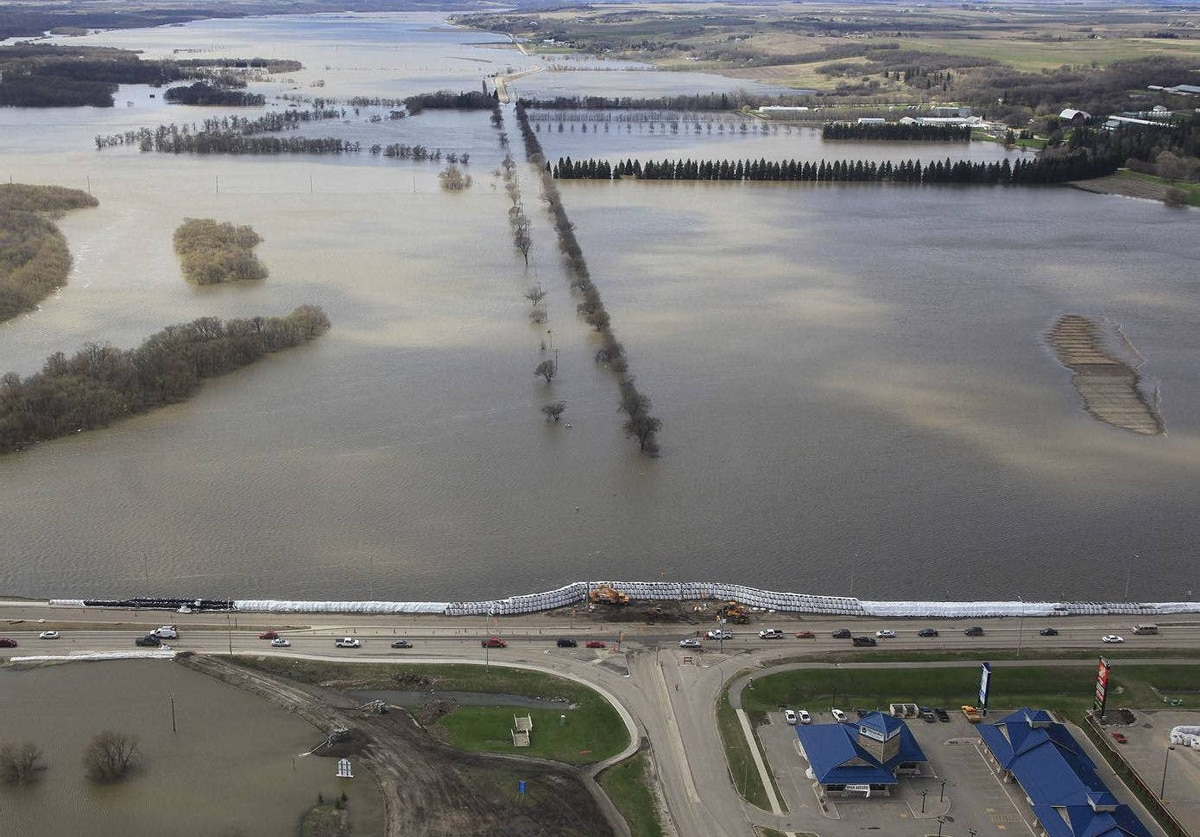 An aerial photo showns the Assiniboine River and 18th Street in the Brandon flood zone in Manitoba. Prime Minister Steven Harper toured the area Wednesday.