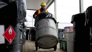 A city worker wheels a steel drum containing old pots of household paint at the household hazardous waste depot at Commissioners St. transfer station in Toronto on Wednesday February 1, 2012.Photo by Chris Young for The Globe and Mail