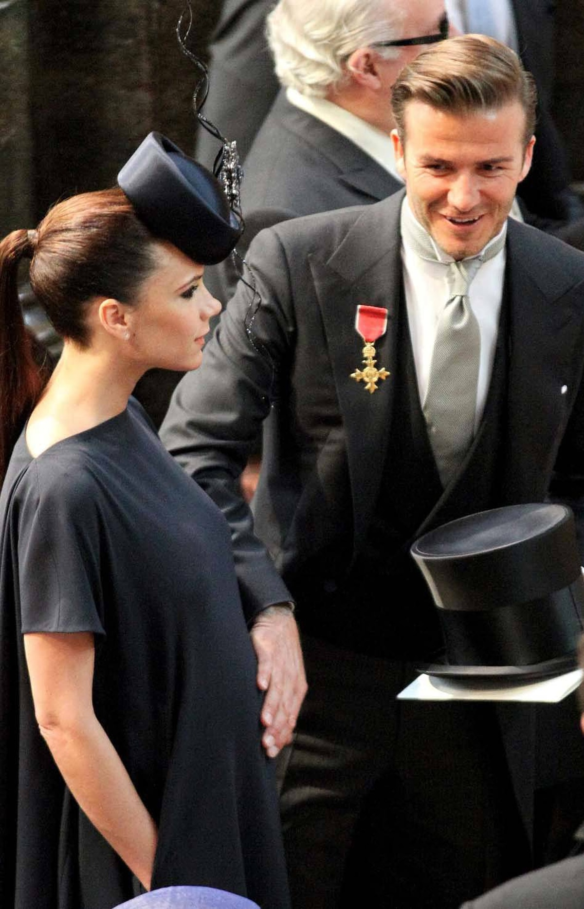 So, what's left? Royal weddings! Soccer star David Beckham puts his hand on the stomach of his pregnant wife Victoria as they take their seats for the Royal wedding of Prince William and Kate Middleton at Westminster Abbey in London on April 29, 2011.