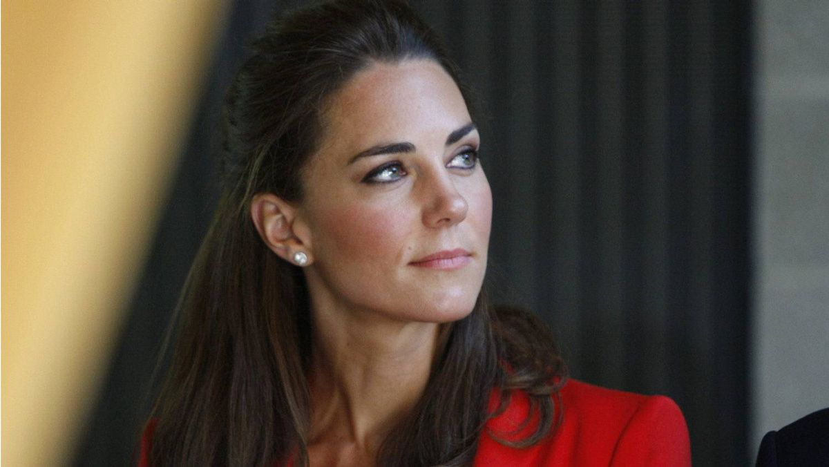 The Duchess of Cambridge listens to a speaker during a tour of the ENMAX Conservatory at the Calgary Zoo in Calgary, Friday July 8, 2011.