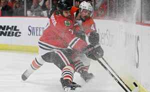 Danny Briere #48 of the Philadelphia Flyers fights for the puck against Brent Seabrook #7 of the Chicago Blackhawks in Game Five of the 2010 NHL Stanley Cup Final at the United Center on June 6, 2010 in Chicago, Illinois. (Photo by Bruce Bennett/Getty Images)