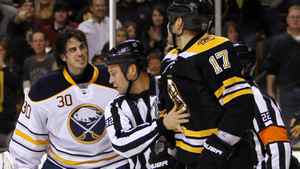 Buffalo Sabres goalie Ryan Miller (30) has some words with Boston Bruins left wing Milan Lucic (17) after being charged during the first period at TD Banknorth Garden. The Sabres announced on Sunday Miller suffered a concussion on the play. Greg M. Cooper-US PRESSWIRE
