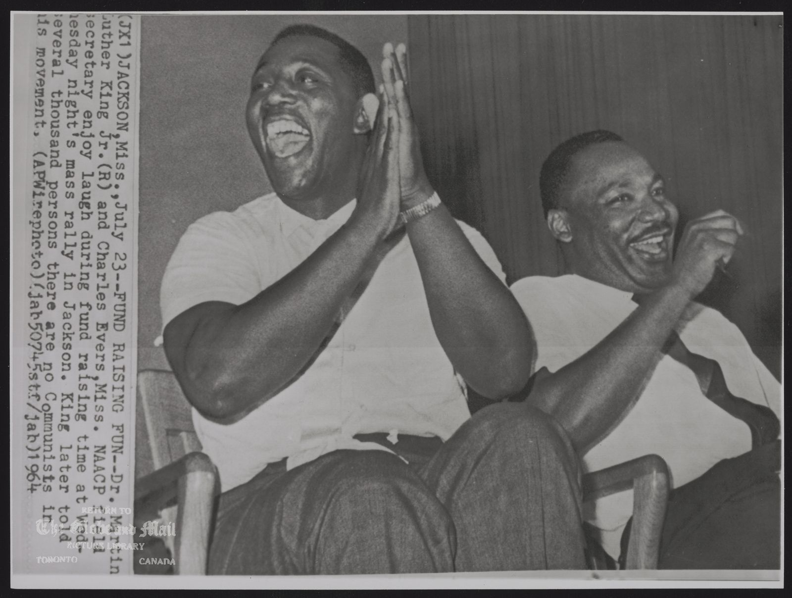 CHARLES EVERS U.S.A. NAACP exec. (JX10) JACKSON,Miss.,July 23--FOUND RAISING FUN--Dr. Martin Luther King Jr.(R) and Charles Evers, Miss. NAACP field Secretary enjoy laugh during fund raising time at Wednesday night's mass rally in Jackson. King later told serveral thousand persons there are no Communists in his movement, 1964