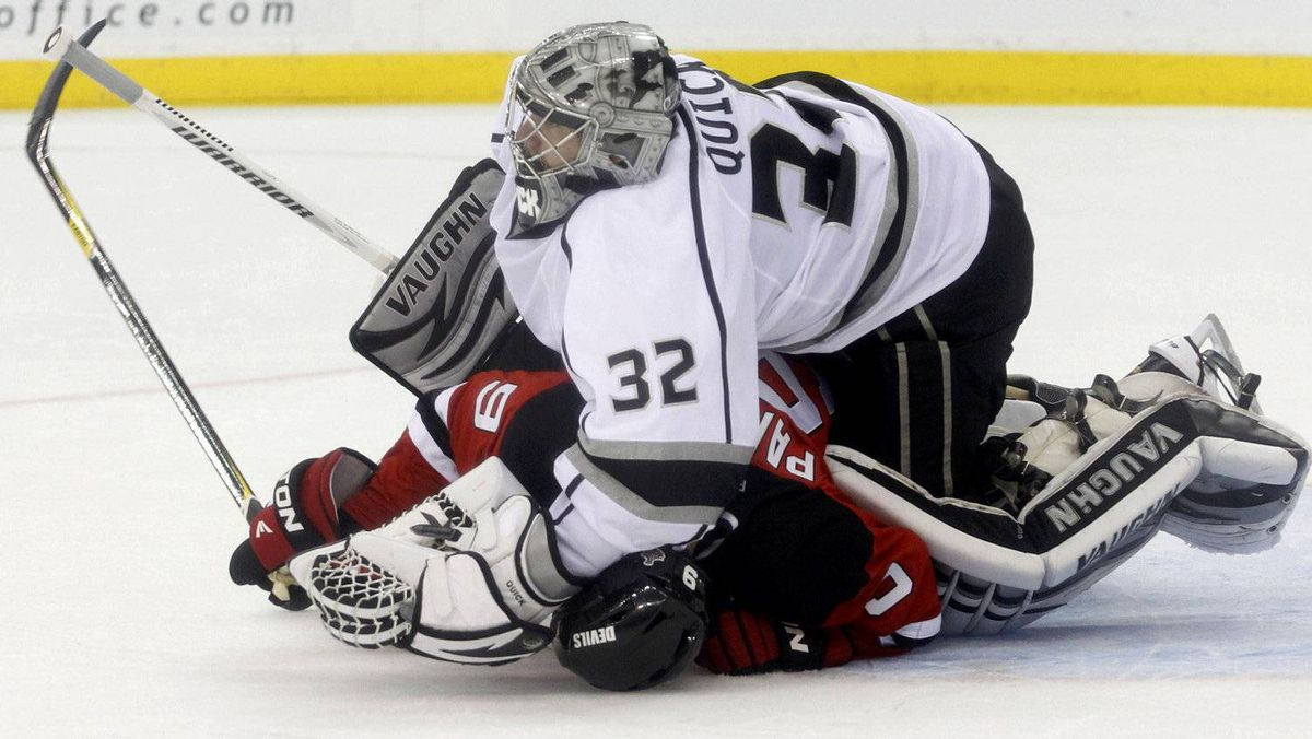 New Jersey Devils' Zach Parise (bottom) collides with Los Angeles Kings goalie Jonathan Quick during the second period in Game 1 of the Stanley Cup final in Newark, New Jersey, May 30, 2012.