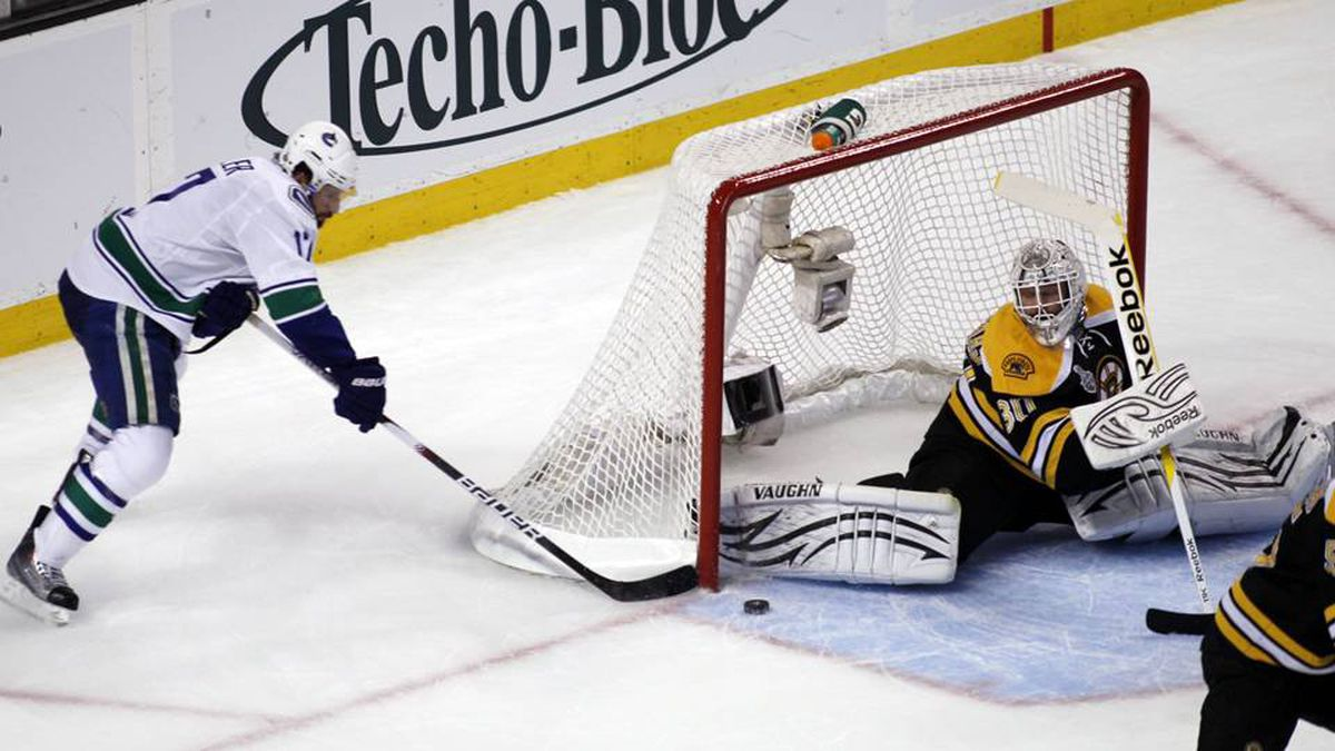 Boston Bruins goalie Tim Thomas makes a save on a shot by Vancouver Canucks centre Ryan Kesler.