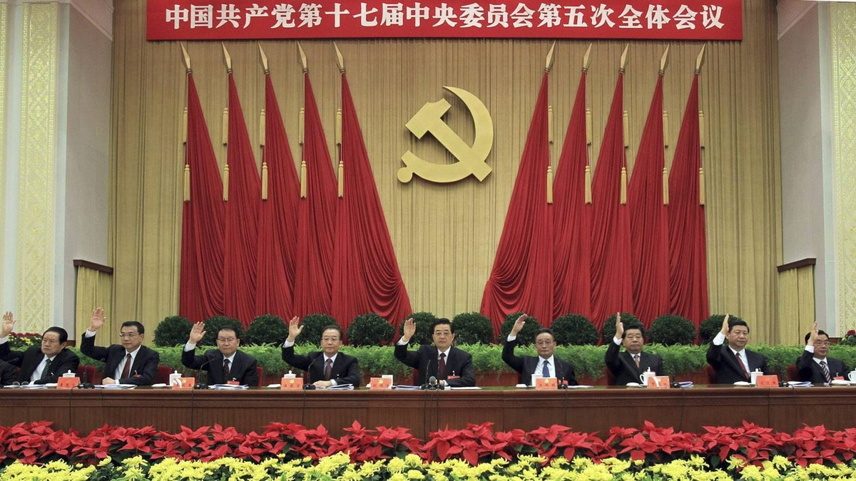 In this photo released by China's Xinhua News Agency on Monday, Oct. 18, 2010, Chinese President Hu Jintao, center, and other top Chinese leaders attend the Fifth Plenary Session of the 17th Central Committee of the Communist Party of China (CPC) held in Beijing for Oct. 15-18, 2010. Chinese Vice President Xi Jinping, second right, was promoted to vice chairman of a key Communist Party military committee on Monday at the meeting in the clearest sign yet he remains on track to take over as the country's future leader within three years. From left are, Zhou Yongkang, Li Keqiang, Li Changchun, Wen Jiabao, Hu Jintao, Wu Bangguo, Jia Qinglin, Xi Jinping, He Guoqiang.