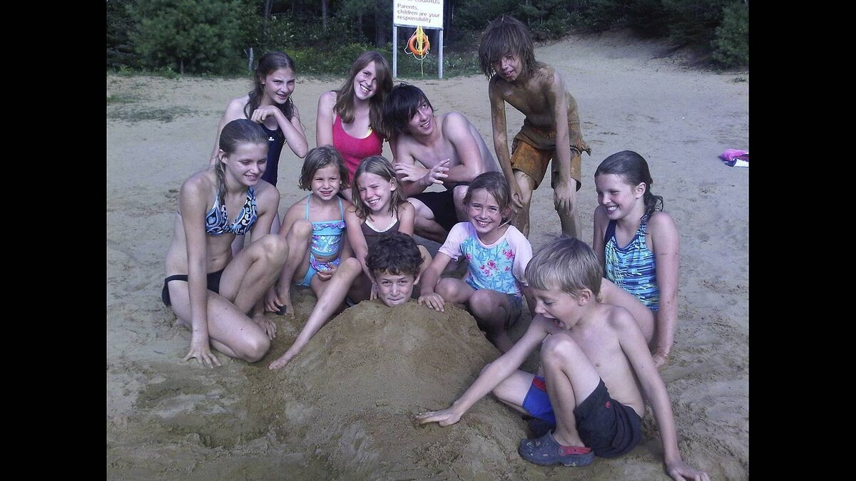 Greg Blackhurst photo: Beach fun - Each year we do a Dad's and kids camping trip. This is the kids enjoying the beach at Arrowhead Provincial Park this August. Evan, the good sport was buried by his friends for a photo.