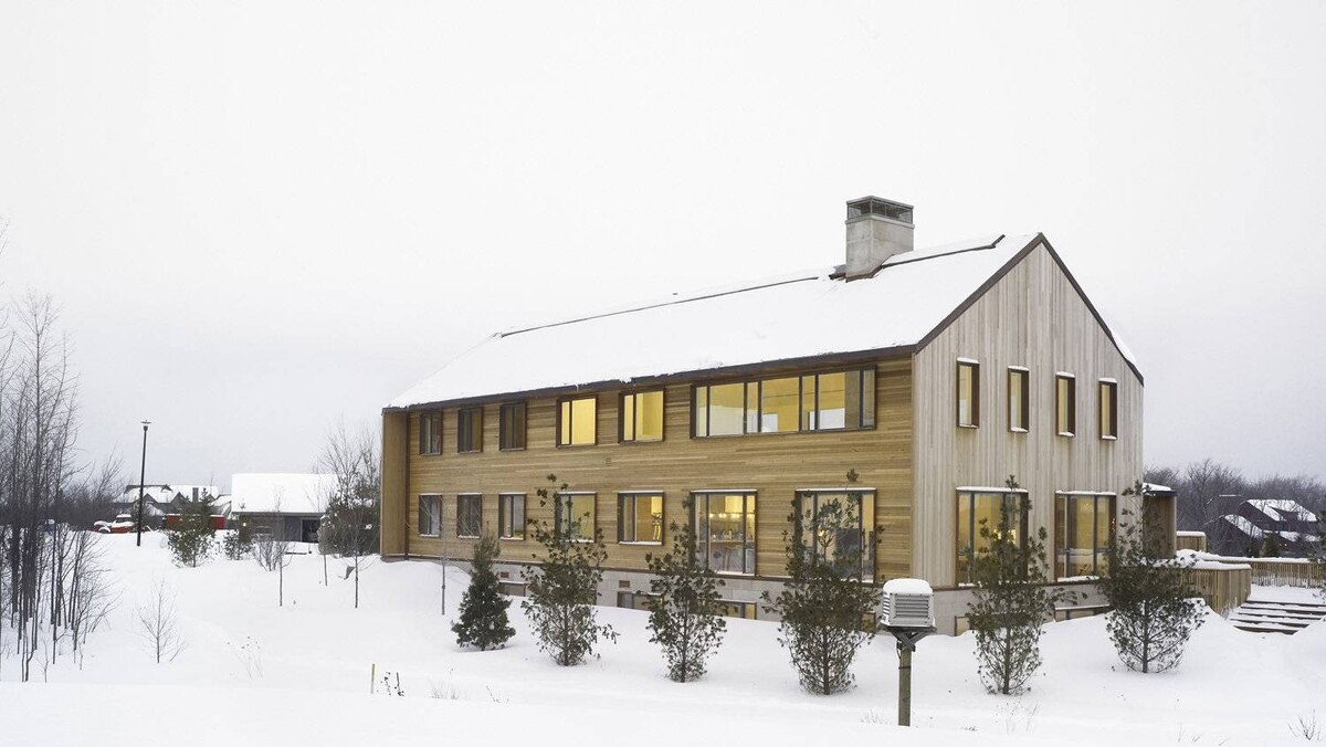 The home created by architects Rob Kastelic and Kelly Buffey for Toronto clients at the foot of an Ontario ski hill. The design is pure and simple in form yet country comfortable.