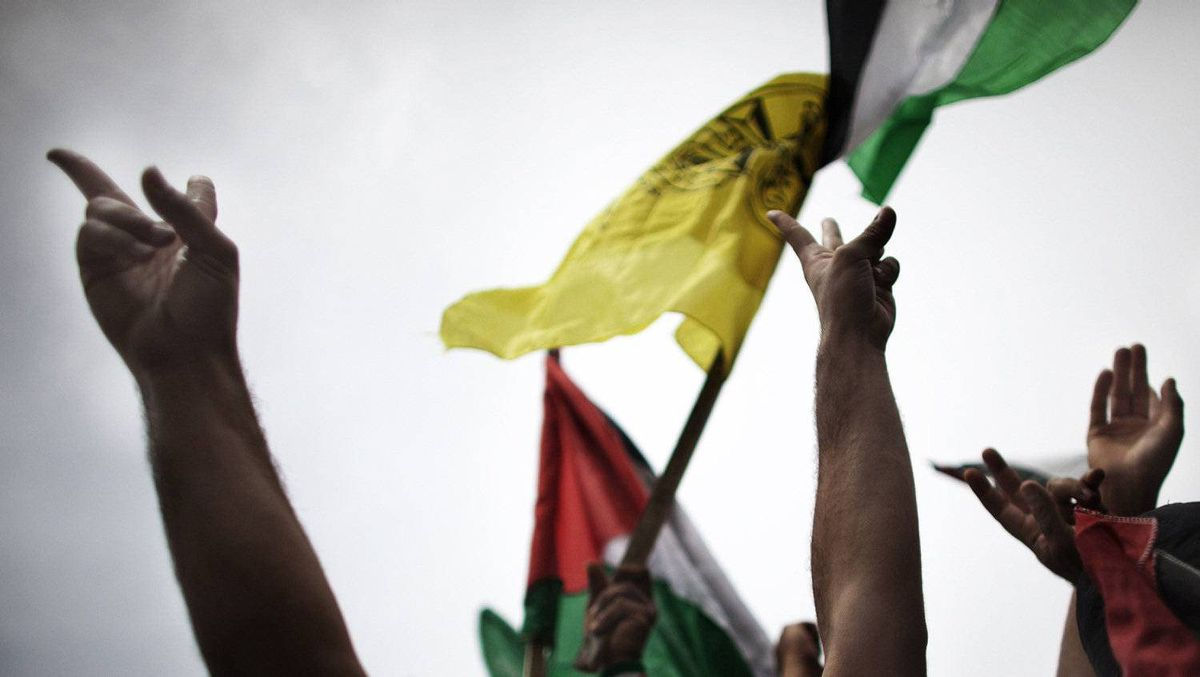Palestinians from the Gaza Strip celebrate the political unity deal in a demonstration at the Unknown Soldier square in Gaza City where for the first time since 2007 the yellow Fatah flag is allowed to be displayed on May 4, 2011.