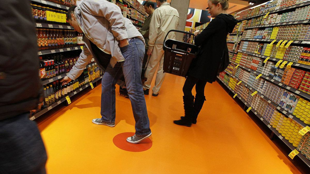 A customer steps on the red dot at what was centre ice in the old Maple Leaf Gardens, the former home of the Toronto Maple Leafs hockey team. With its newest store, Loblaw has paid tribute to the building's heritage.