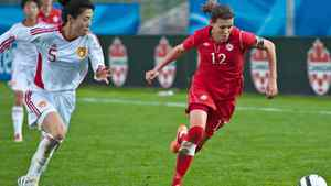 Canada's Christine Sinclair tries to out run China PR's Dongni Wang during a Women's International Friendly soccer match in Moncton, N.B.on Wednesday May 30, 2012.