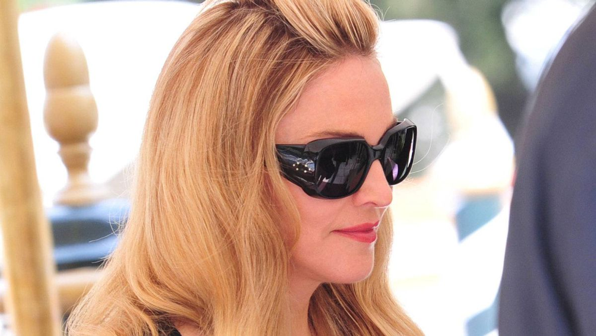 Singer and film director Madonna disembarks from a boat as she arrives at the 68th Venice Film Festival on September 2, 2011.