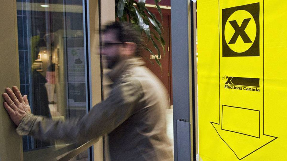 A voter leaves a polling station in St. Laurent, Que., on Oct. 14, 2008l