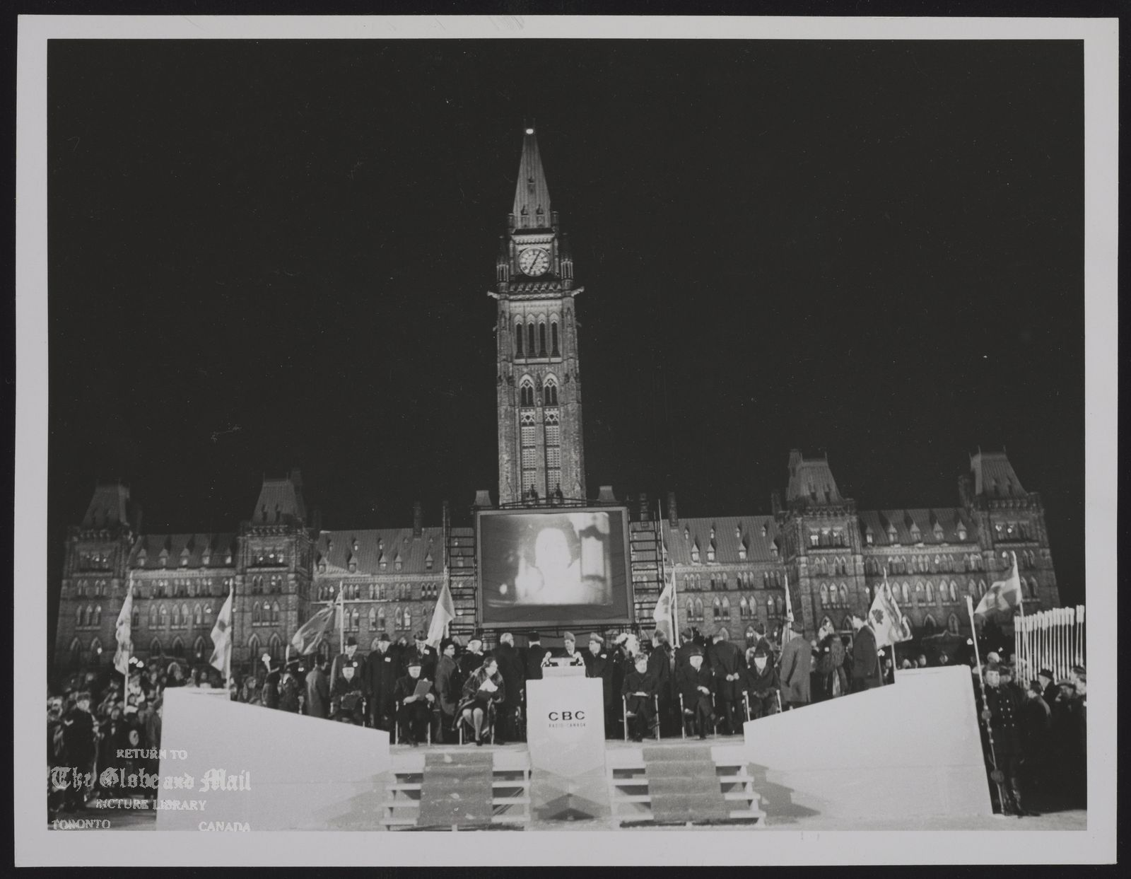 The notes transcribed from the back of this photograph are as follows: CANADA dominion Centennial Centennial ceremony on Parliament Hill on New Year's Eve