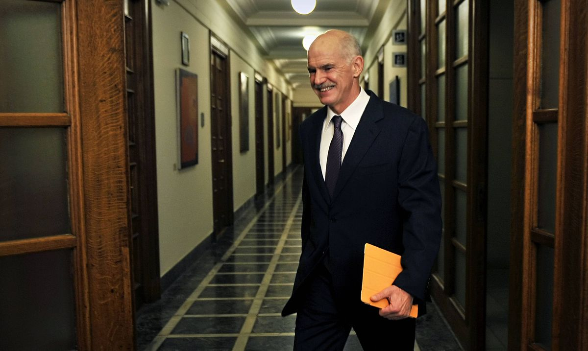 Greek Prime Minister George Papandreou arrives for a cabinet meeting in Athens on Tuesday.