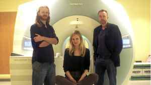 Brain researchers (from left) Dr. Damian Cruse, Beth Parkin MSC, and Dr. Adrian Owen at Cambridge University. Dr. Owen and his team will be researching recorded electrical impulses in the brain of comatose people showing they are actually aware and can respond by thinking of things.