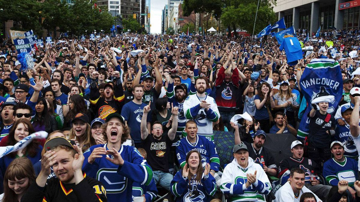 Vancouver Canucks fans react to a play as they watch Game 6 of the NHL Stanley Cup hockey playoff against the Boston Bruins on a big screen in downtown Vancouver, June 13, 2011.