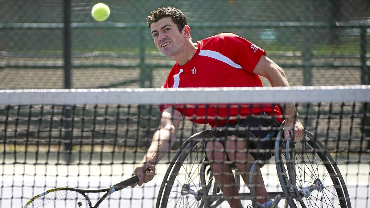 Wheelchair tennis player and paralympic hopeful Joel Dembe trains with his coach in Toronto.
