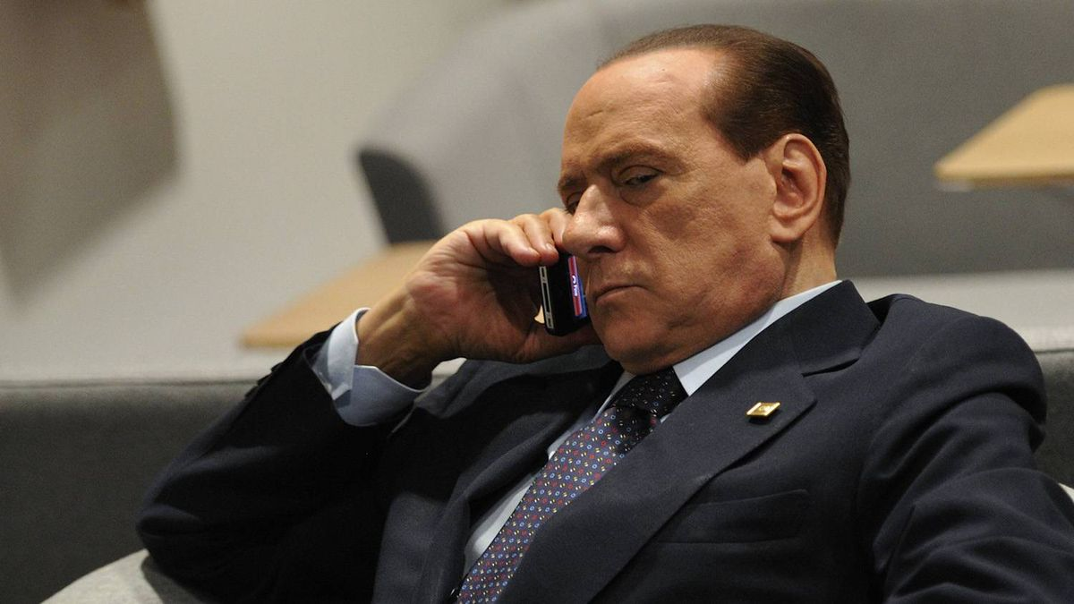 Italian Prime Minister Silvio Berlusconi phones prior to an European Council at the Justus Lipsius building, EU headquarters in Brussels on October 23, 2011.