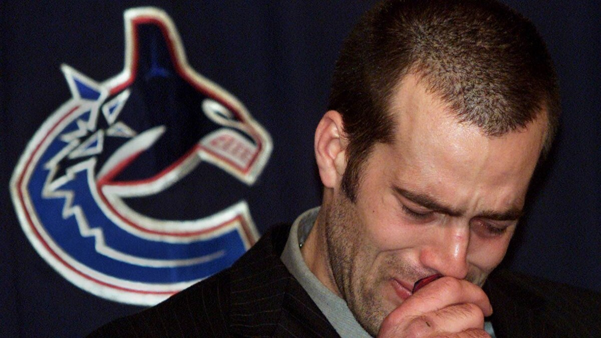Vancouver Canucks Todd Bertuzzi cries as he apologizes for sucker-punching Steve Moore of the Colorado Avalance during an NHL game.