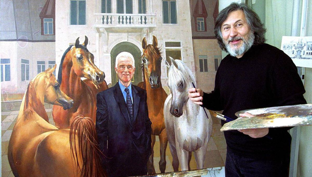 Artist Georgi Danevski puts the finishing touches on a painting of Frank Stronach in Toronto in May, 2003. The painting, which features horses and the Magna head office in the background, is oil on canvas and measures 4' x 5'. It was displayed in the Jockey Hall of Fame at Woodbine race track in Toronto, along with other horse related paintings to be unveiled by jockey Sandy Howley.