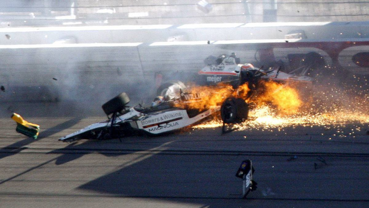 FILE- In this Oct. 16, 2011, file photo, drivers Dan Wheldon, front, and Will Power crash during a wreck that involved 15 cars during the IndyCar Series' auto race at Las Vegas Motor Speedway in Las Vegas. Wheldon died following the crash.