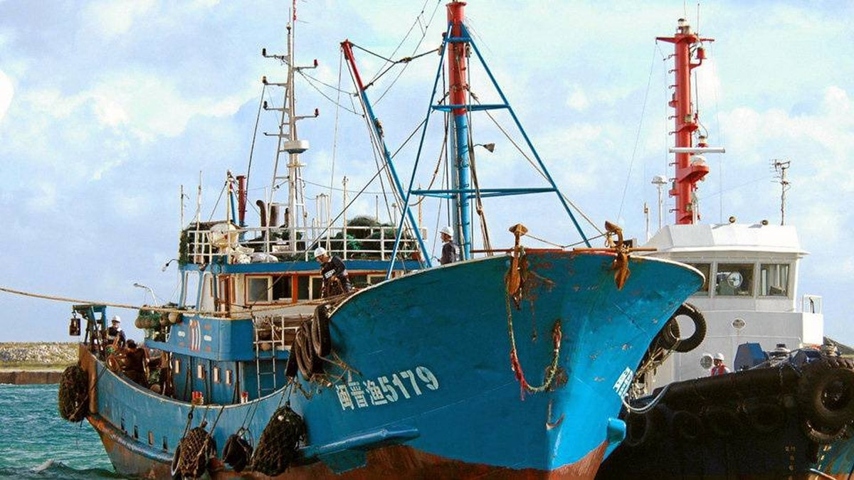In this Sept. 8, 2010 photo, a Chinese fishing boat, left, which was involved in a collision near disputed islands, arrives at a port on Ishigaki island, Okinawa prefecture, southwestern Japan. Japanese prosecutors decided Friday, Sept. 24, 2010, to release the captain of the Chinese fishing boat, whose detention raised tensions between the Asian neighbors. Beijing has angrily demanded that the captain be released and cut off ministerial-level talks with Japan as relations between the two countries spiraled to their worst level in years.