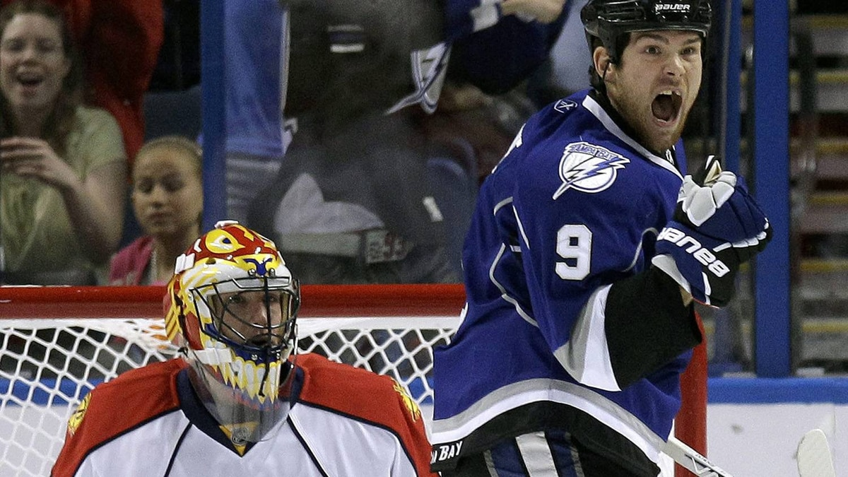 Tampa Bay Lightning right wing Steve Downie (9) celebrates after teammate Marc-Andre Bergeron, not shown, scored a first period goal past Florida Panthers goalie Scott Clemmensen (30) during an NHL hockey game in Tampa, Fla., Saturday, Feb. 19, 2011. (AP Photo/Chris O'Meara)