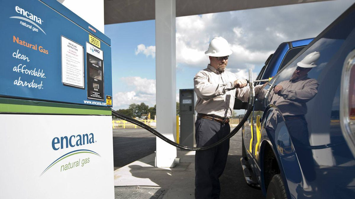An employee filling up his natural gas truck at Encana's new compressed natural gas (CNG) fueling station in Louisianas Red River Parish, which was opened on November 30, 2010.