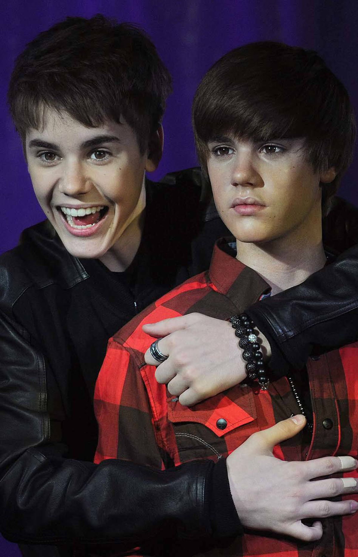 The very next day -- THE VERY NEXT DAY! -- Justin Bieber was in London for the unveiling of his likeness at Madame Tussauds decidely passé wax museum.