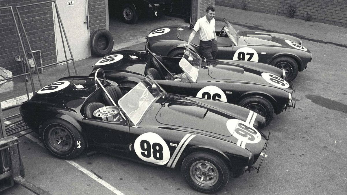 Shelby with the three Cobra roadsters that would win the 1963 USRRC Manufacturer's Championship.