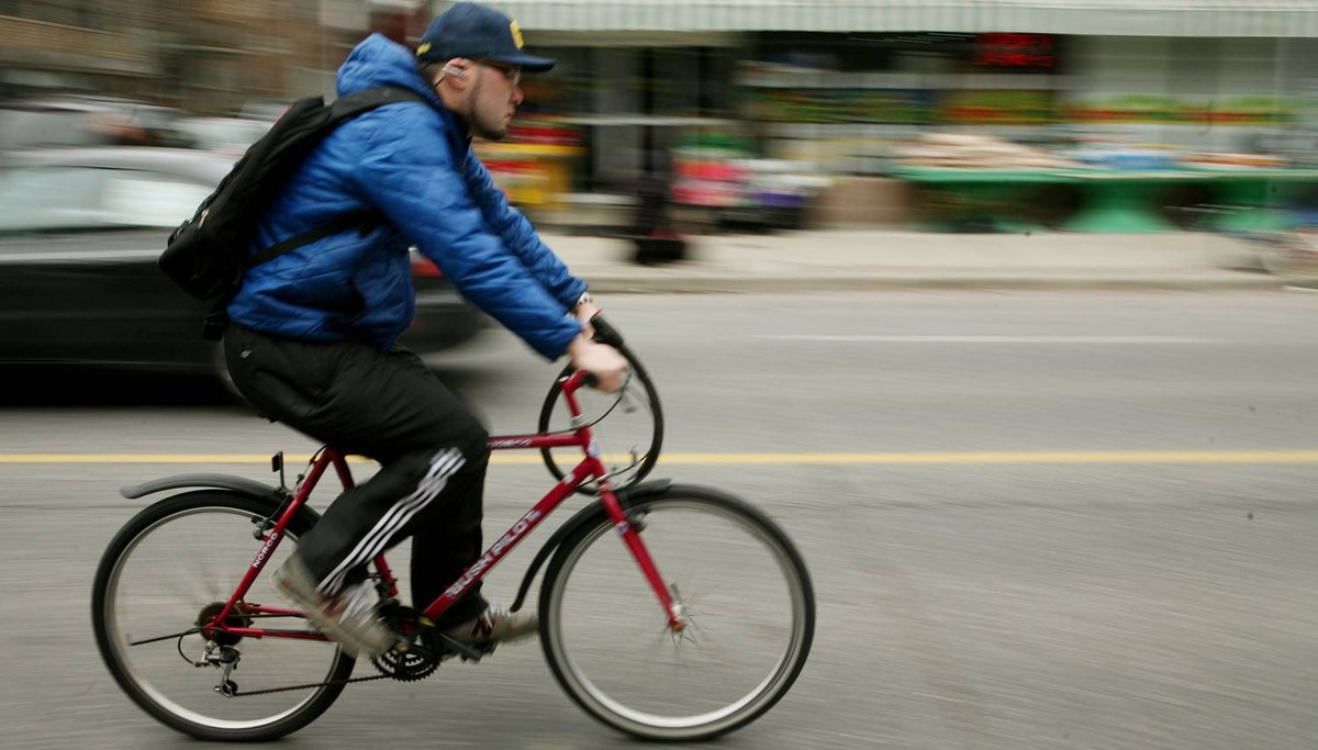 A cyclist rides in downtown Toronto.